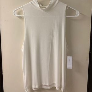 A white tank top/blouse from American Eagle.